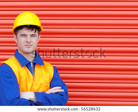 Portrait of a young worker wearing a hardhat - stock photo