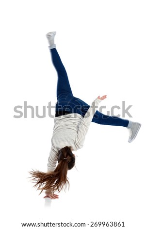 Portrait of active girl making one handed cartwheel on white background - stock photo