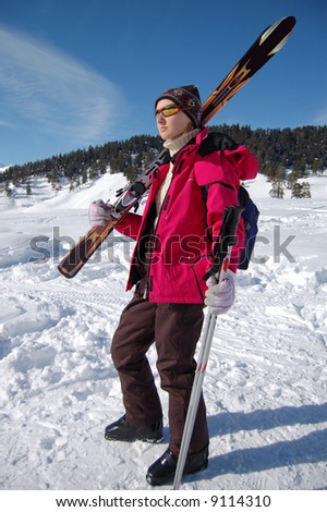 Portrait of active girl with ski on her shoulders - stock photo