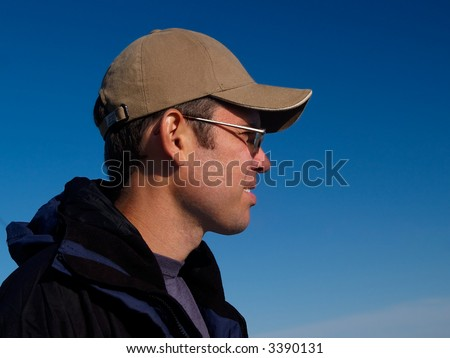 portrait of active young man against blue sky