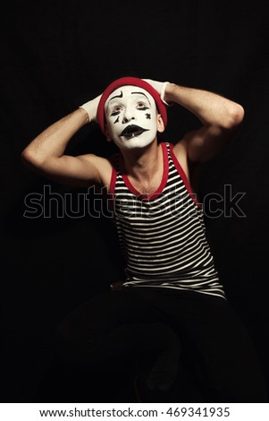 Portrait of actor mime on black background