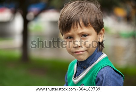 Portrait of adorable and fashionable little boy outdoor at the nice summer day - stock photo
