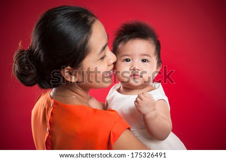 Portrait of adorable baby and his mother - stock photo