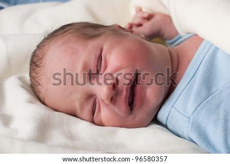 Portrait of adorable baby boy crying - stock photo