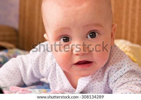 Portrait of adorable baby boy looking at camera - stock photo