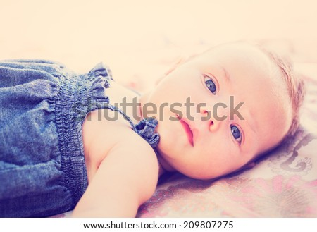 Portrait of adorable baby girl, vintage style warm color tone - stock photo