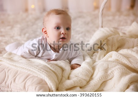 Portrait of adorable baby on the floor, close up