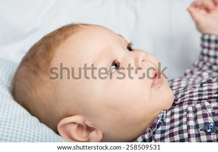 Portrait of adorable infant baby boy with red hair - stock photo