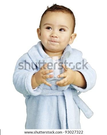 portrait of adorable infant with blue bathrobe holding a glass - stock photo
