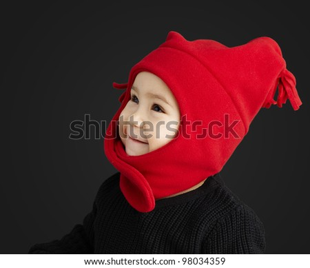 portrait of adorable kid over black background - stock photo