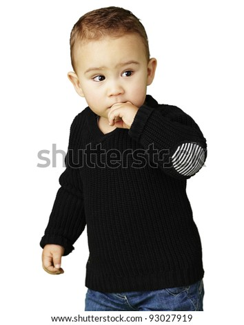 portrait of adorable kid thinking against a white background