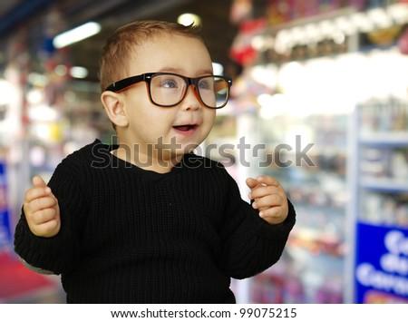 portrait of adorable kid wearing vintage glasses at shop - stock photo