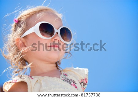 Portrait of adorable little girl in sun glasses