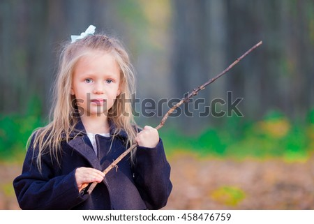 Portrait of adorable little girl outdoors at beautiful autumn day - stock photo