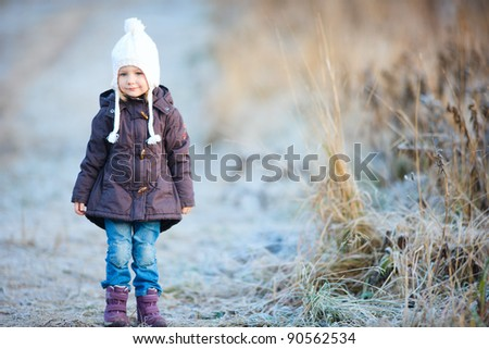 Portrait of adorable little girl outdoors on cold winter day - stock photo