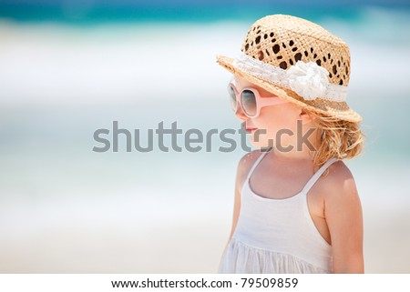 Portrait of adorable little girl wearing elegant hat - stock photo