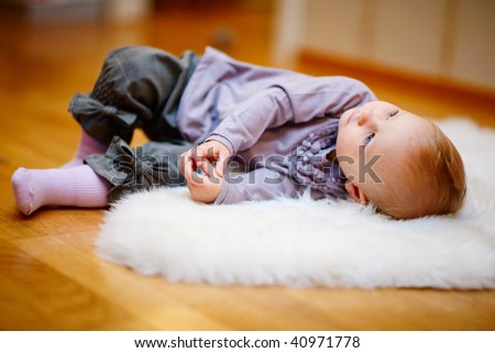 Portrait of adorable 15 months old baby girl in casual clothes