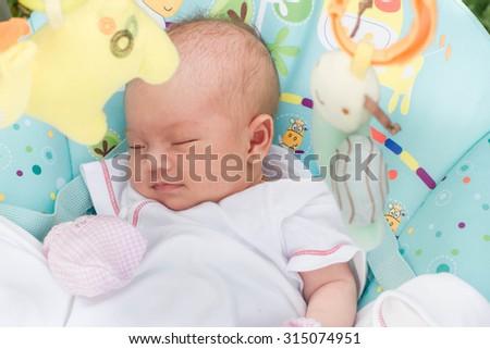 portrait of adorable newborn baby asleep , cute infant sleeping  - stock photo