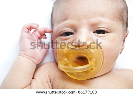 portrait of adorable newborn baby girl on white background