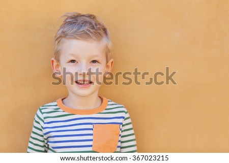 portrait of adorable positive toddler  - stock photo