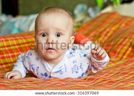 Portrait of adorable serious baby boy - stock photo