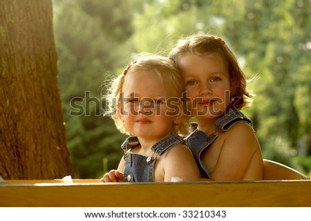 Portrait of 2 adorable sisters - stock photo