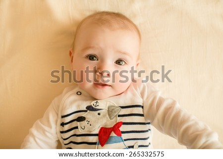 Portrait of adorable smiling newborn baby - stock photo