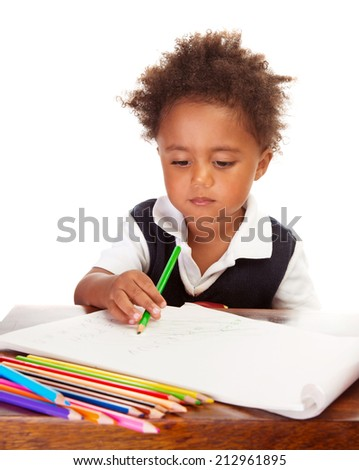 Portrait of adorable sweet little black boy drawing using many colorful pencil, isolated on white background, back to school concept - stock photo