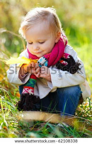 Portrait of adorable toddler girl in autumn park