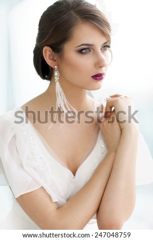 Portrait of adorable woman in natural light - stock photo