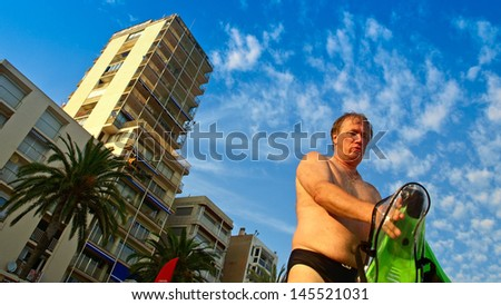 Portrait of adult active healthy man is going to go scuba diving - stock photo
