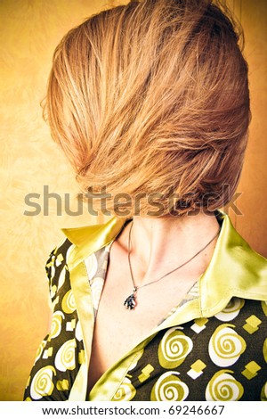 Portrait of adult attractive woman indoor staying against wall and posing - stock photo