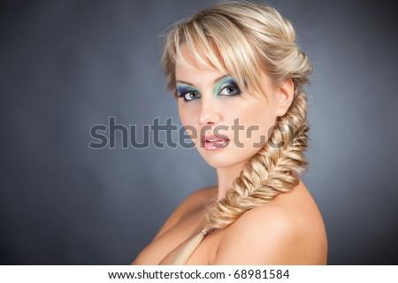 Portrait of adult blond woman, close up studio shot - stock photo
