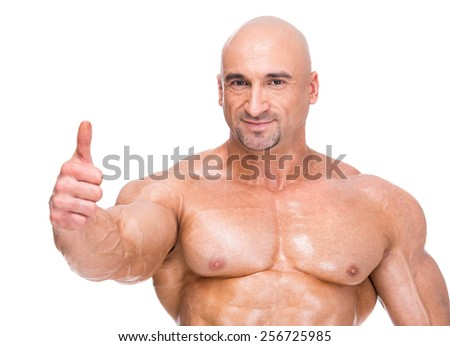 Portrait of adult bodybuilder isolated on white background. - stock photo
