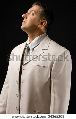 Portrait of adult boss against black background - stock photo