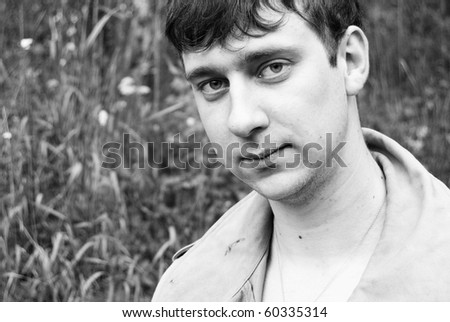 Portrait of adult man with sad look and ironic smile