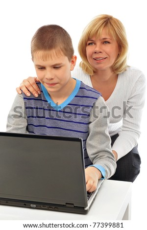 Portrait of adult woman watching as her son doing homework using his laptop and fast wireless internet. Copyspace. Isolated on white background - stock photo