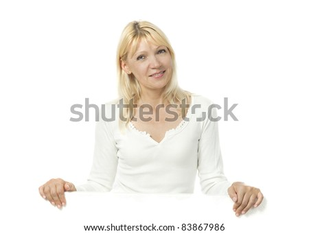 Portrait of adult woman with empty bulletin board smiling at camera - stock photo