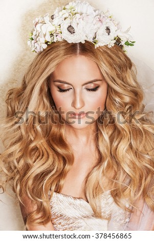 Portrait of affectionate blond woman. Beautiful bride with wedding makeup, hairdo and wedding decorations. Wedding ideas and bridal style.  - stock photo