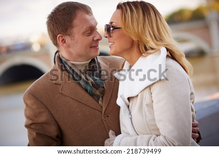 Portrait of affectionate couple looking at one another outside - stock photo