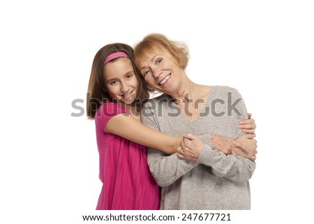 Portrait of affectionate grandmother and granddaughter - stock photo