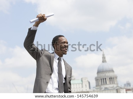 Portrait of Afircan American businessman celebrating - stock photo