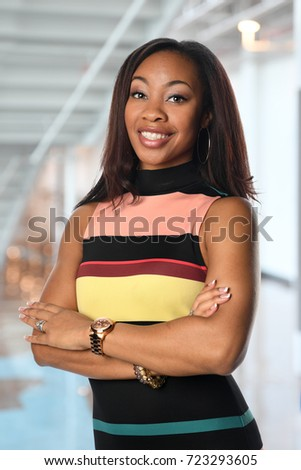 Portrait of African Amererican businesswoman with arms crossed inside building