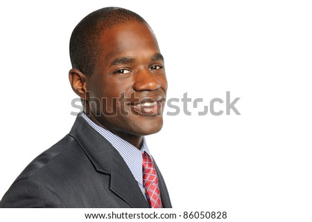Portrait of African American businessman smiling isolated over white background - stock photo