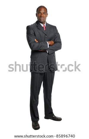 Portrait of African American businessman with arms crossed isolated over white background