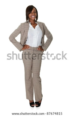 Portrait of African American businesswoman standing confidently on white background.