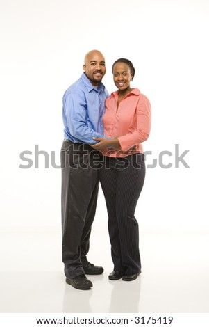 Portrait of African American couple with arms around eachother against white background. - stock photo