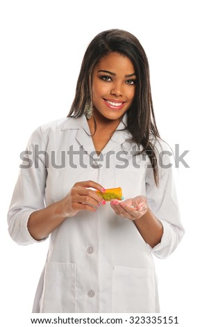 Portrait of African American doctor holding prescription medicine isolated over white background