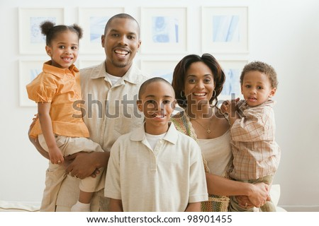Portrait of African American family indoors - stock photo