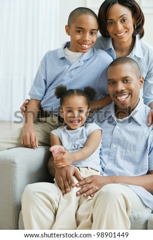 Portrait of African American family on sofa - stock photo